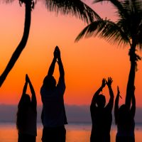 Sunrise yoga activity on the beach
