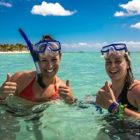 Ladies snorkeling in Caribbean