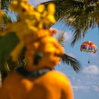 Couple paragliding over Caribbean Sea